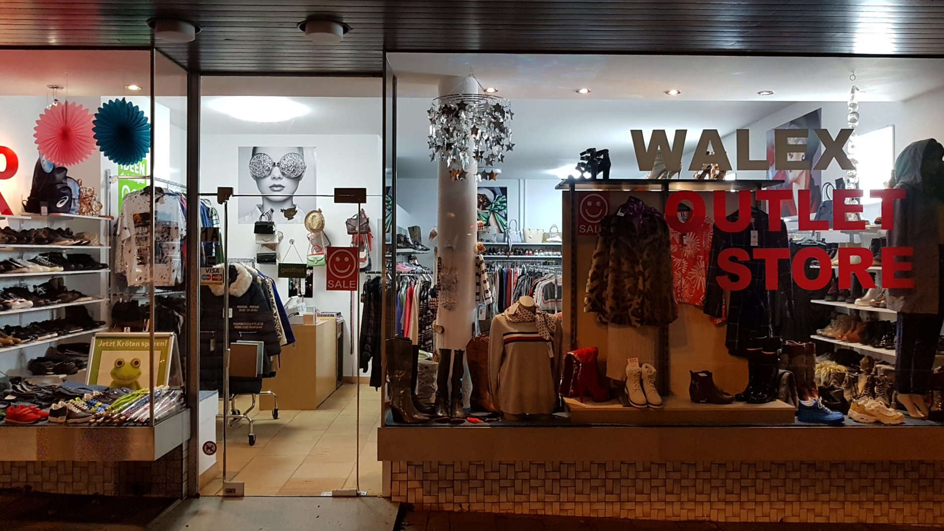 Shop window with various items of clothing
