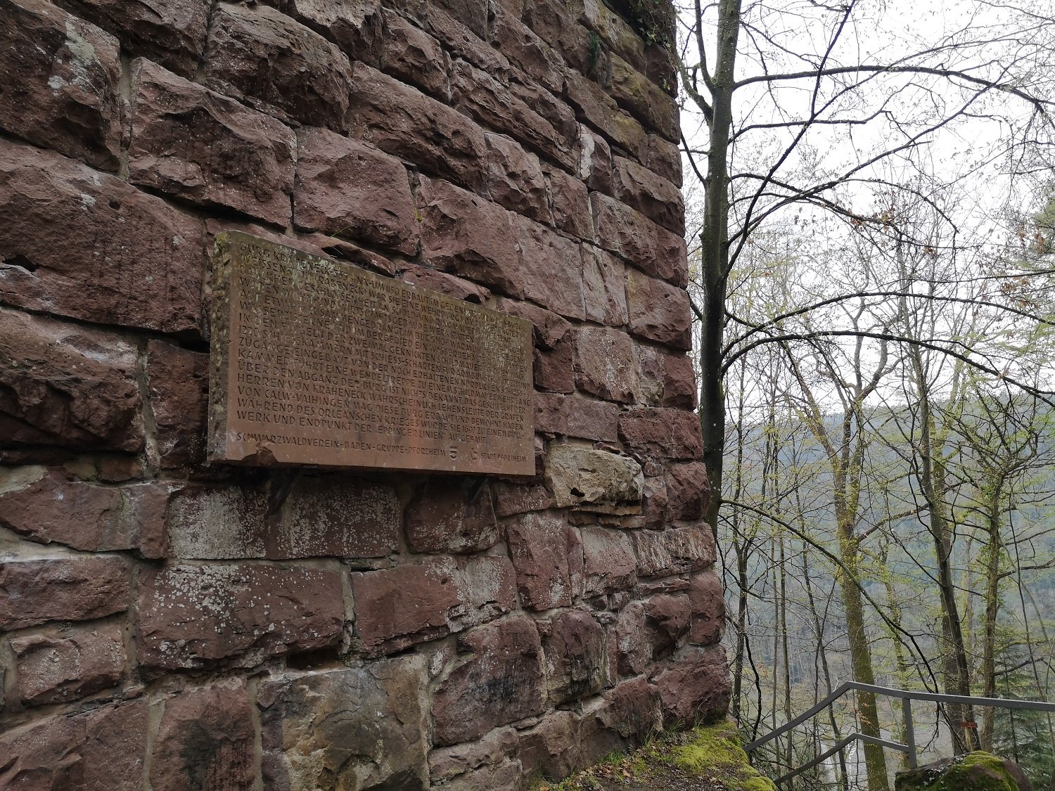 A stone tablet on the wall of the ruin