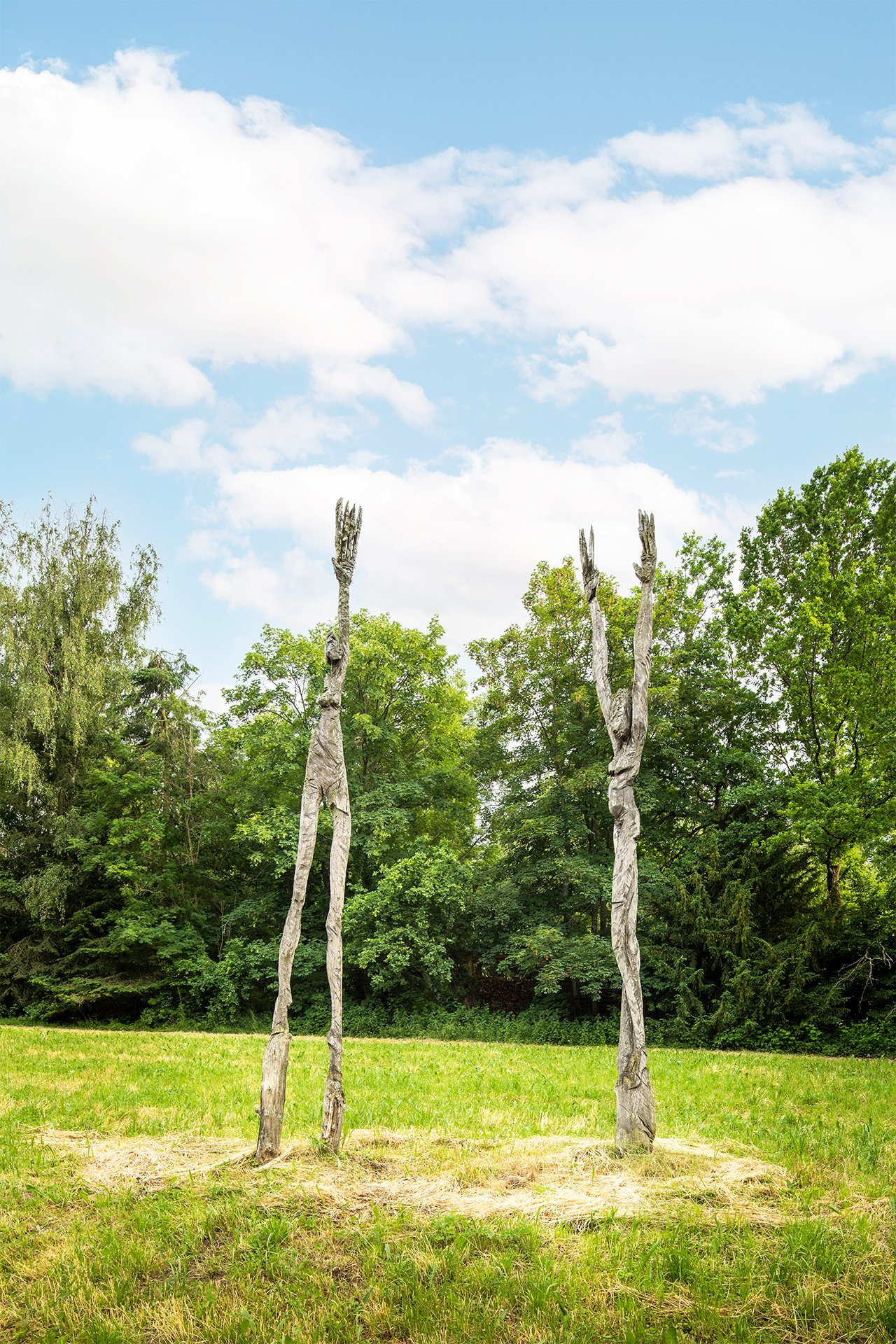 """The sculpture """"Dream Dance"""" by Charlotte Szukala shows two wooden people dancing"""